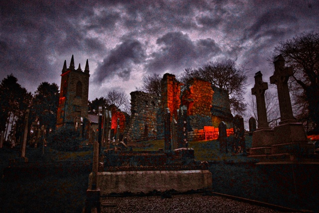 The ruins of the Ecclesiastical city of St Mullins as night closes in